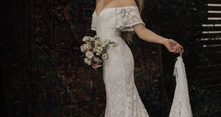 Callista Bohemian Wedding Dress. OFF SHOULDER lace boho wedding gown with FRINGE hem and buttons. Made to Measure in California. size 0-18