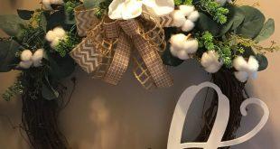 Monogram farmhouse wreath with magnolia flower and cotton.